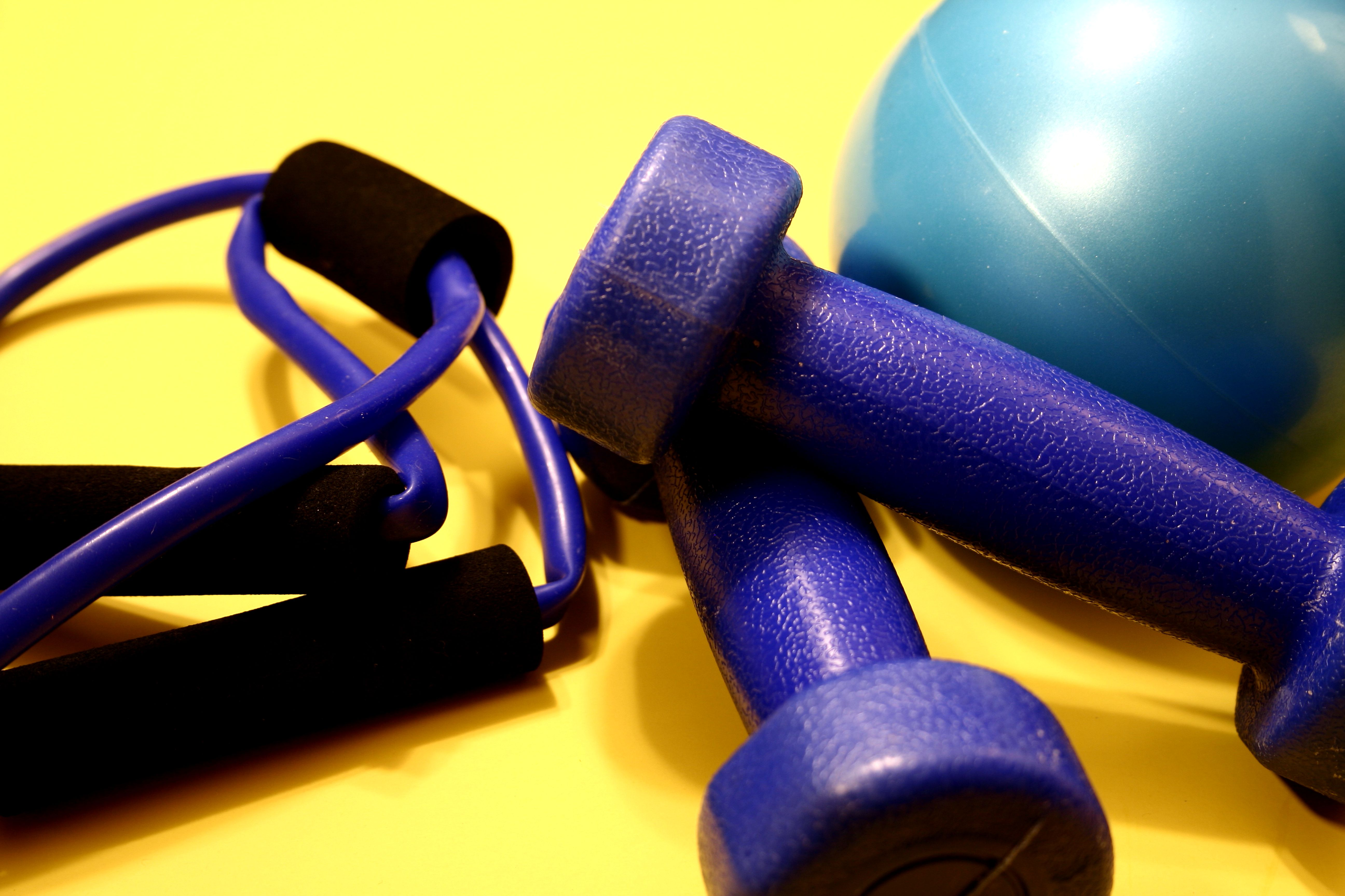 exercise-equipment-including-a-turquoise-rubber-ball